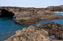 Entrance to Arch. Baia - A natural bay formed by volcanic lava from past eruptions with natural arch surrounded by the blue waters of the Atlantic creating a Stock Photography