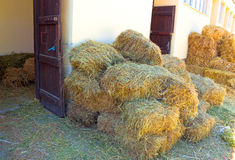 The entrance to the barn. A pile of hay in front of the stables,photography Royalty Free Stock Images