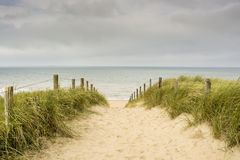 Entrance to the beach on the Dutch west coast near Katwijk, the Netherlands. Entrance to the sandy beach on the Dutch west coast near Katwijk, the Netherlands stock photography