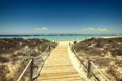 Entrance to the beach with wooden walkway Stock Image