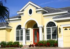 Entrance to Beautiful Home. Entrance to yellow and gray home with white Stock Photos