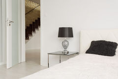 Entrance to bedroom. White entrance door to simple exclusive bedroom Royalty Free Stock Photo
