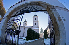 Entrance to Beocin monastery covered with snow at sunny winter morning Stock Photo