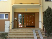 Entrance to a block of flats with mailboxes, bells and ramp for pram stock photos