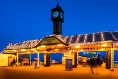 Entrance to Brighton Pier in Brighton, England. The Brighton Marine Palace and Pier is a pleasure pier in Brighton, England. It is generally known as the Palace Stock Photo