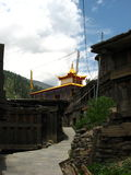 Entrance to Buddhist Pagoda. Entrance gate to golden Buddhist Pagoda at Kalpa town, a tiered tower with religious functions at Himachal Pradesh, India, forest Royalty Free Stock Image