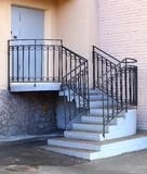 Entrance to the building, concrete porch with metal railings. The entrance to the building, concrete porch with metal railings royalty free stock photography