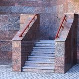Entrance to the building, porch tiled with artificial marble with stone steps. The entrance to the building, porch tiled with artificial marble with stone steps stock photos