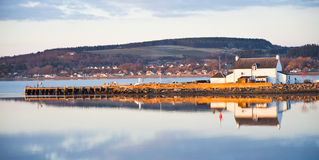 Entrance to the Caledonian Canal at sunset. Royalty Free Stock Images