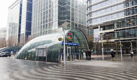 Entrance to Canary Wharf Underground station in London city, United Kingdom. Big Ben in background Royalty Free Stock Photography