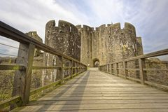 Cardiff castle. city of cardiff, wales, united kingdom. perspective. Entrance to cardiff castle from bridge with stone arches and arrow slits. image taken during stock photo