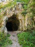Dark rocky cave entrance Royalty Free Stock Photography