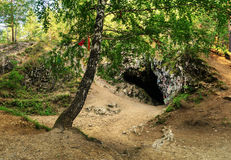 At the entrance to the cave Sugomak Royalty Free Stock Photography