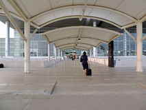 Entrance to Chandigarh International Airport, India. A lady is entering the Chandigarh International Airport with black travel bag. Chandigarh Airport is an Royalty Free Stock Image