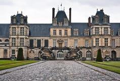 Entrance to the Chateau de Fontainebleau, Paris. Chateau de Fontainebleau on a rainy day, residence of Napoleon I, Paris, France royalty free stock photo