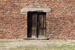 Entrance to the cheap houses for Auschwitz prisoners Stock Photos