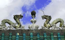 Entrance to Chinese temple. Dragons on top of a Chinese temple in Hong Kong Royalty Free Stock Photography