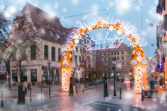 Christmas Tree in Strasbourg, Alsace, France. Entrance to the Christmas Market and inscription Strasbourg Capital of Christmas, Decorated and illuminated in Old Royalty Free Stock Images