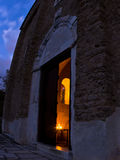 Entrance to church inside Studenica monastery at evening Stock Photography