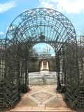 Entrance to the city park. Wicker arch with interesting ornaments. In the center of the park is a swimming pool stock photo