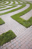 Entrance to a Cobblestone and Grass Maze Royalty Free Stock Images