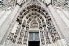 Entrance to Cologne Cathedral. Figures of saints on the facade. Stock Photo