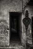 Entrance to dark alley in Fes medina, black and white image. Royalty Free Stock Photo