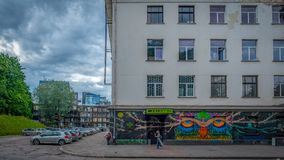 Entrance to a discotheque in a Soviet era neoclassical building in Vilnius royalty free stock photos