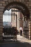 Entrance to Dublin Castle, Dublin, Ireland. With female model for scale Royalty Free Stock Photography