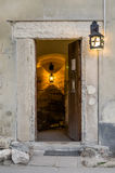 Entrance to the dungeon of an old building illuminated lantern light Stock Images