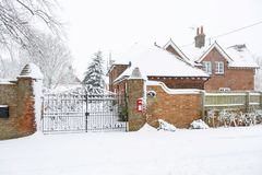 House exterior in winter. Entrance to an English country house exterior covered in snow in winter stock images