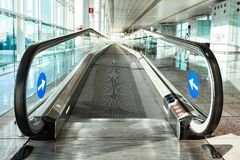 The entrance to the escalator at the airport. Day, glass walls, modern hall Royalty Free Stock Photos