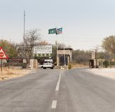 Entrance to Etosha. ETOSHA NATIONAL PARK, NAMIBIA - SEPTEMBER 03, 2017: A vehicle enters the Anderson Gate of Namibia`s Etosha National Park Royalty Free Stock Photography