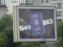 The entrance to Europe - visa-free regime for Ukraine. KHARKOV, UKRAINE - SUMMER 2017: Billboard with a picture of a Ukrainian passport on the background of the Royalty Free Stock Image