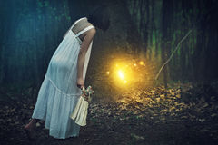 Entrance to fairies realm. Young woman finds entrance to fairies realm in a magical forest . Fantasy concept stock image