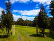 Entrance to a farm. Entrance to a beautiful green  farm Royalty Free Stock Photography