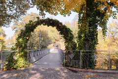Entrance to the footbridge over the arch in the autumn Royalty Free Stock Photos