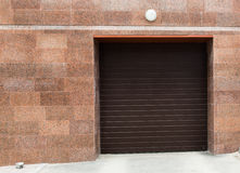Entrance to the garage, block, storage, with sliding doors. Royalty Free Stock Photography