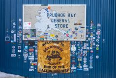 The entrance to a general store adorned with stickers at deadhorse in the arctic circle. A sign welcoming newcomers to the one shop at the oil-drilling town of Stock Photo