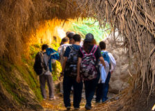 The entrance to the gorge of Ein Gedi and passing it on young travelers. Royalty Free Stock Photo