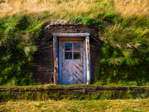 Entrance to the grass house Stock Photography