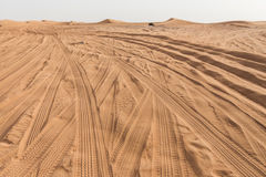 Entrance to The Great Desert with Tire Traces and Sand Mountain at Dubai Royalty Free Stock Images