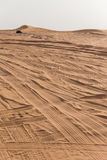 Entrance to The Great Desert with Tire Traces and Sand Mountain at Dubai Stock Images