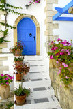Entrance to a Greek house. With a traditional blue door on Crete, Greece Stock Image
