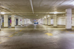 Entrance to a grungy empty parking area Royalty Free Stock Photo