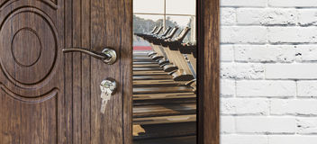 Entrance to gym in fitness club, opened door with treadmills Stock Photography