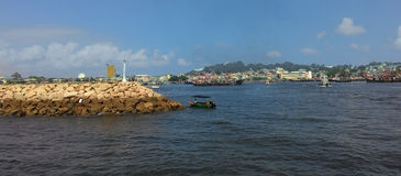 Entrance to the Harbour at Cheung Chau, Hong Kong. Hong Kong - July 2016 A view of Cheung Chau Harbour as the ferry passed the entrance royalty free stock photo
