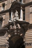Entrance to historic GPO building, built 1866-1874 with Queen Victoria supported by classical allegories and coat of arms over the royalty free stock images