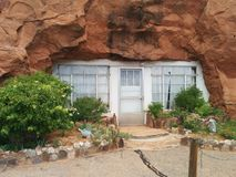 Entrance to Hole N` The Rock mountain home with soot over the door stock image