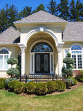 Entrance to Home. Front entrance to home with decortive iron glass doors and pillars stock photo